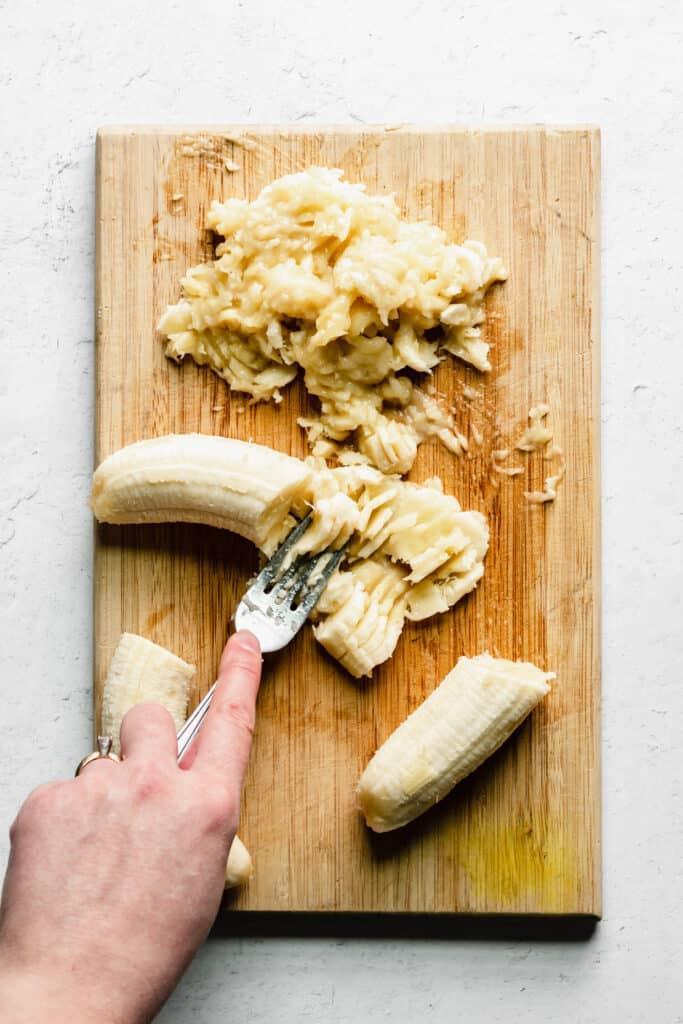 mashing the bananas for the banana nut muffins