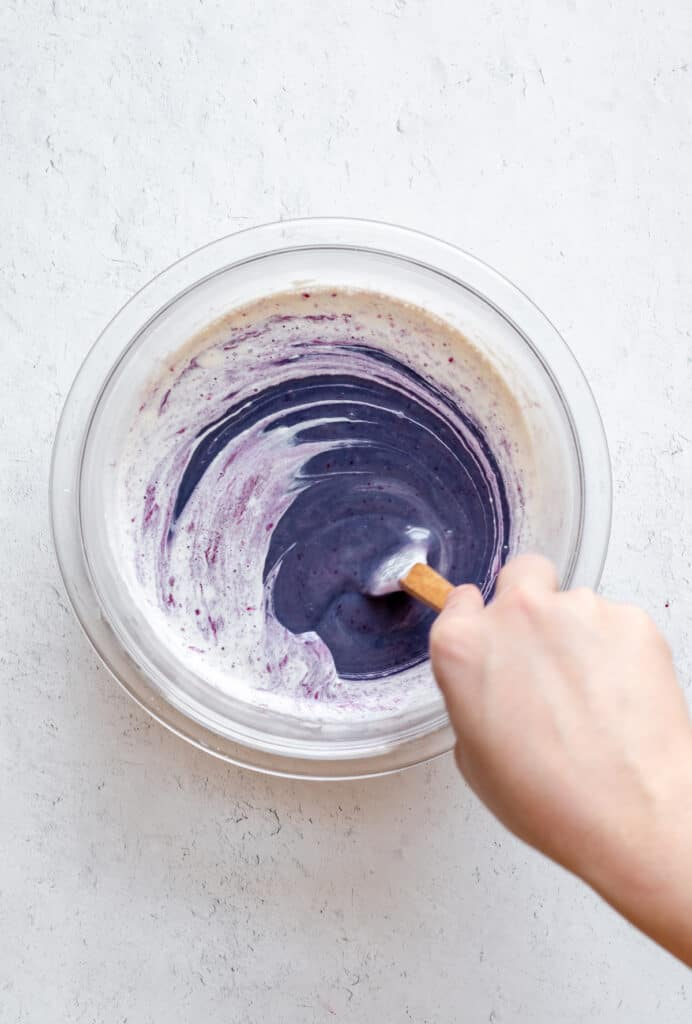 Purple color comes through the heavy cream as the blueberry ganache is stored together