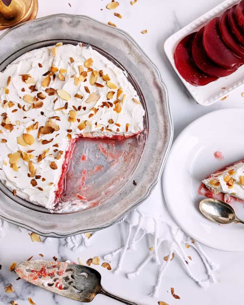 Top down photograph of the frozen cranberry pie with a slice on a plate