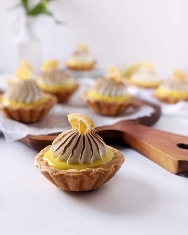 Head on shot of one tartlet shell will multiple tartlets in the background